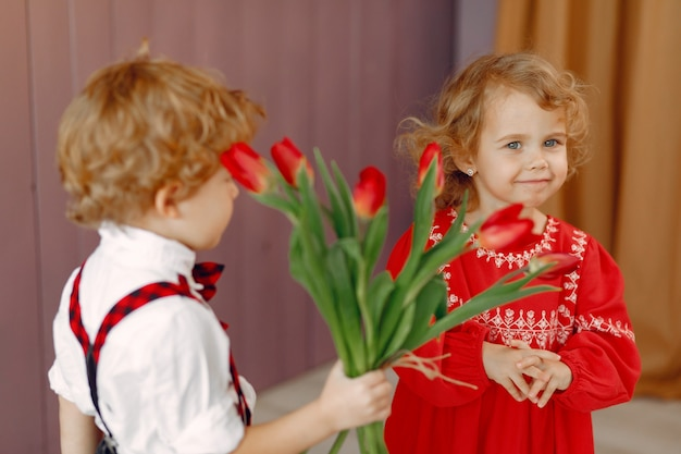 Elegant little kids with bouquet of tulip