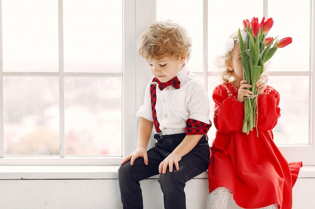 Elegant little kids with bouquet of tulip