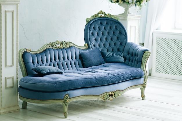 Elegant living room in blue tones.  velor blue luxury sofa