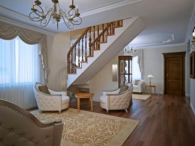 흰색 벽과 짙은 갈색 쪽모이 세공 마룻 바닥으로 된 계단이있는 개인 주택의 우아한 거실입니다.