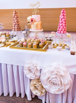 Elegant and luxurious event arrangement with colorful pastries