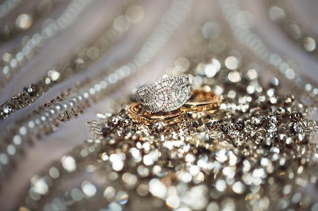 Elegant luxury bridal jewelry on golden background