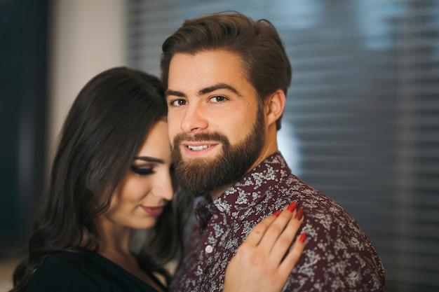 Elegant man embracing woman
