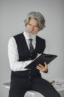 Elegant man in office. businessman in white shirt. man works with documents.
