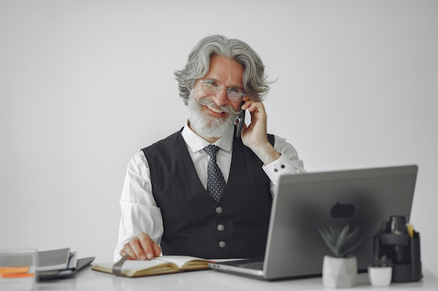 Elegant man in office. businessman in white shirt. man works with phone.
