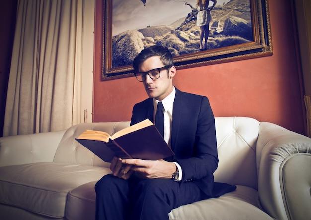 Elegant man reading a book