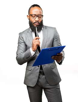 Elegant man reviewing a checklist
