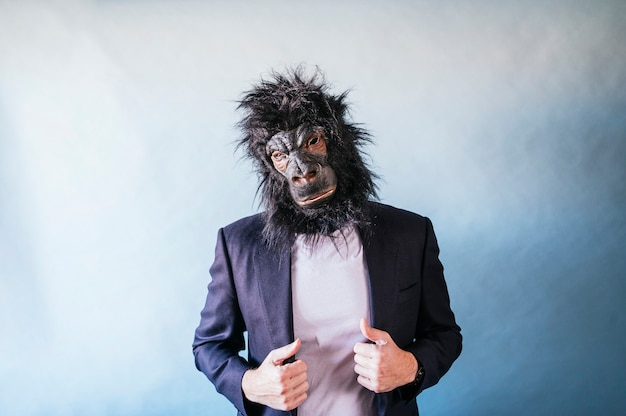Elegant man with gorilla mask posing