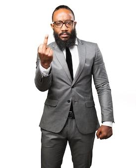 Elegant man with middle finger raised