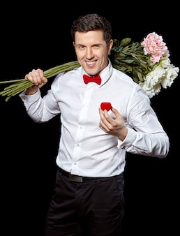 The elegant man with a ring and flowers