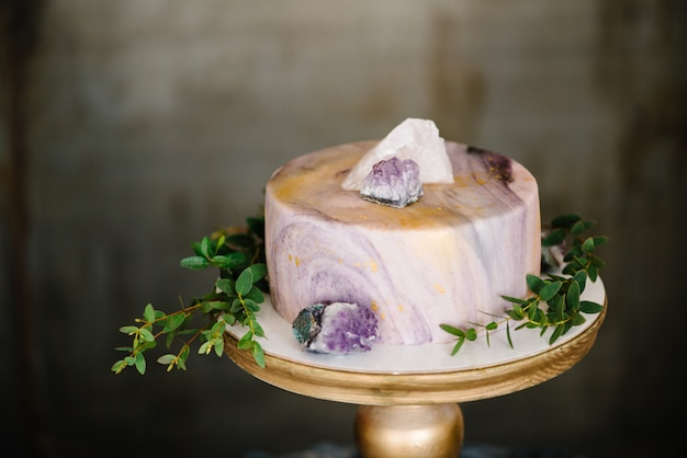 Elegant marble cake with stones, crystals.
