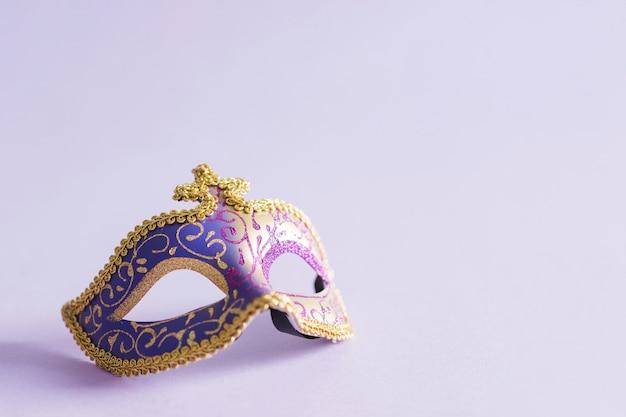 Elegant mask on lilac