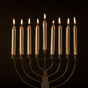 Elegant menorah with golden candles