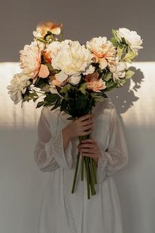 Elegant model holding beautiful bouquet
