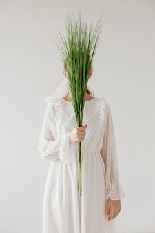 Elegant model holding fresh plants