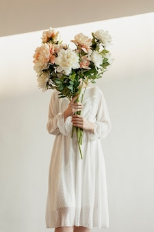 Elegant model holding lovely bouquet