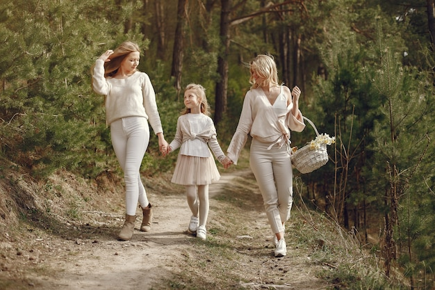 Elegant mother with children in a summer forest