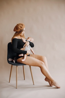 Elegant mother with cute little daughter