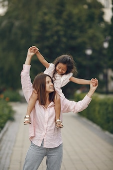 Elegant mother with daughter in a summer park