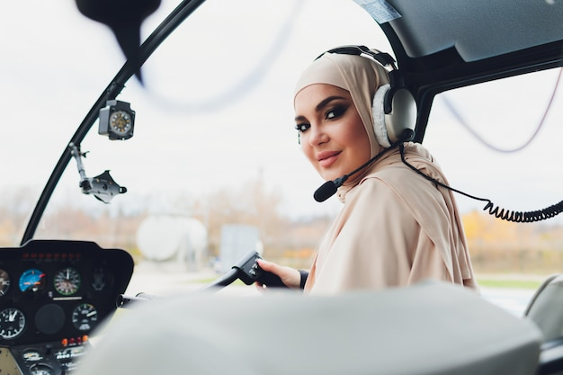 Elegant muslim businesswoman on a helicopter