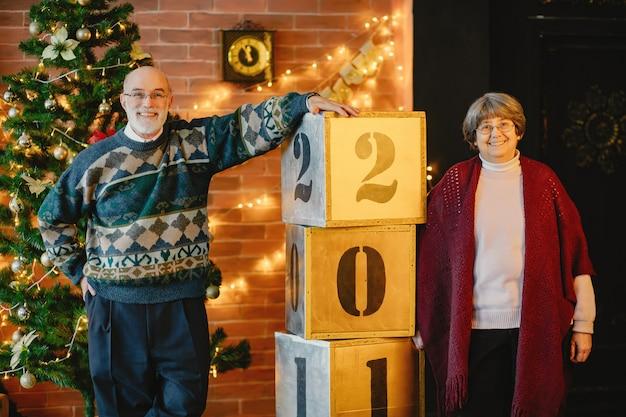 An elegant old couple are celebrating christmas
