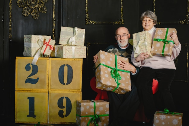 An elegant old couple are celebrating christmas Free Photo