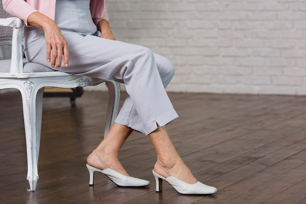 Elegant old lady wearing high heels