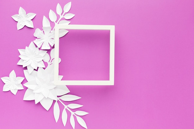 Elegant paper flowers beside frame