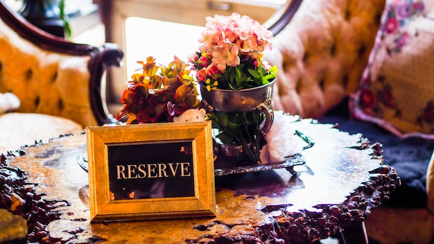 Elegant restaurant table setting service for reception with reserved card . reserved sign on a table in restaurant