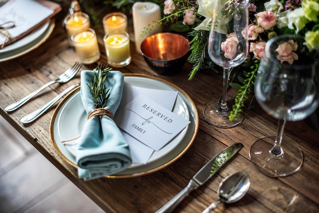 Elegant restaurant table setting service for reception with reserved card
