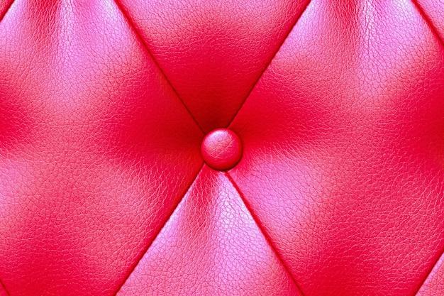 Элегантная насыщенная глянцевая красная кожаная текстура кресла софы.