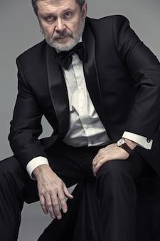 Elegant senior businessman in tuxedo
