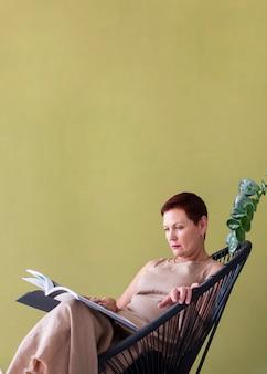 Elegant senior woman reading a magazine