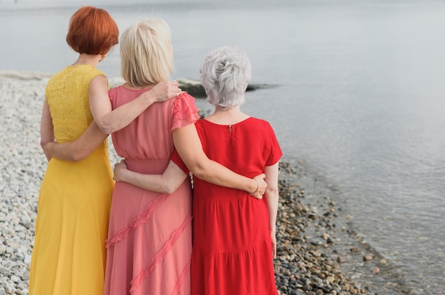 Elegant senior women celebrating friendship