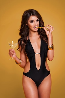 Elegant and sexy woman drinking martini