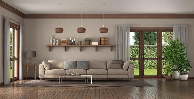 Элегантный диван в большой гостиной с деревянной полкой с книгами