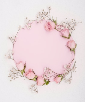 Elegant spring pink roses and white flowers frame