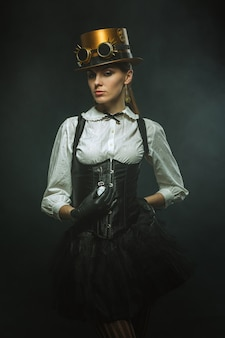 Elegant steampunk woman with the clock