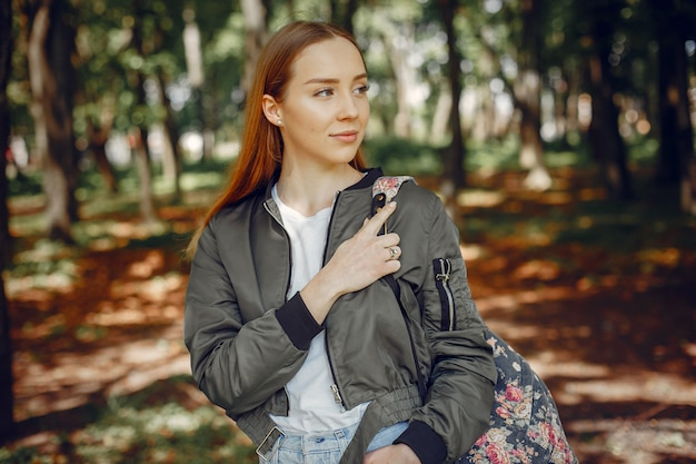 Elegant and stylish girl in a forest