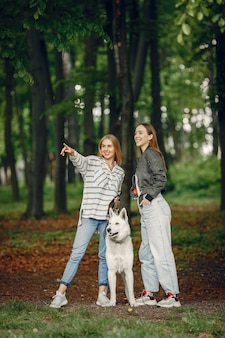 Elegant and stylish girls in a forest
