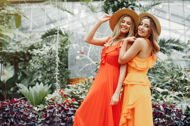 Elegant and stylish girls in a greenhouse