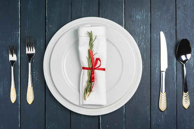 Elegant table setting with festive decor on wooden background