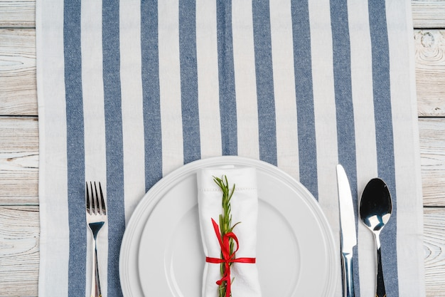 Elegant table setting with festive decor on wooden table