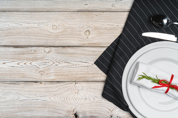 Elegant table setting with festive decor on wooden