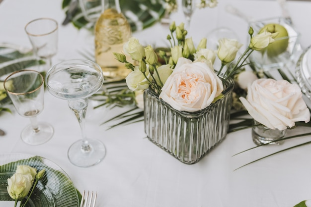 Elegant table setup in green for a wedding