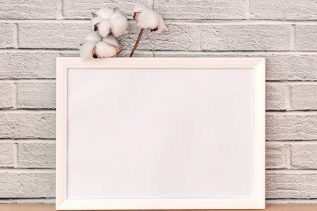 Elegant twig of beautiful white cotton and white board