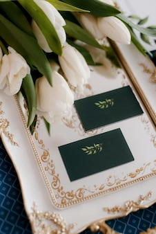 Elegant wedding bouquet of fresh natural flowers and greenery with book