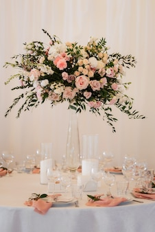 Elegant wedding decorations made of natural flowers and green elements
