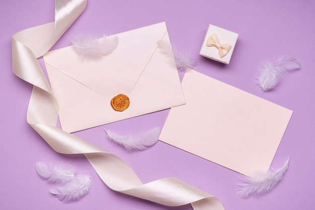 Elegant wedding invitations with ribbon on the table