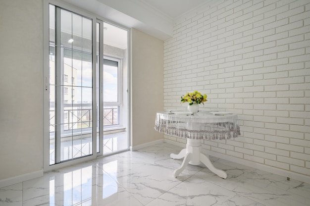 Elegant white round dining table in classic room